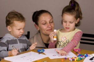 Mother and children doing craft