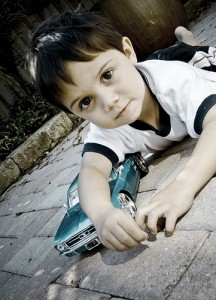 child-w-car_byTheBusyBrain
